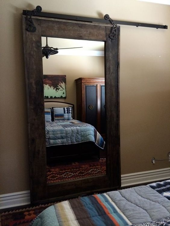 dark stained mirror frame barn door is great for space saving