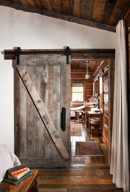 distressed barn doors echo with floors and ceilings