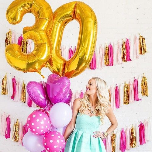 gold 30 balloons and bold pink ones for party decor that echo with tassels on the wall