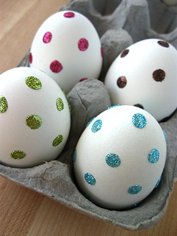 stick clear adhesive dots onto eggs and dip in sprinkles or glitter for easy decorating
