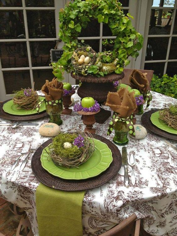 wicker platters, green plates, nests with moss and eggs