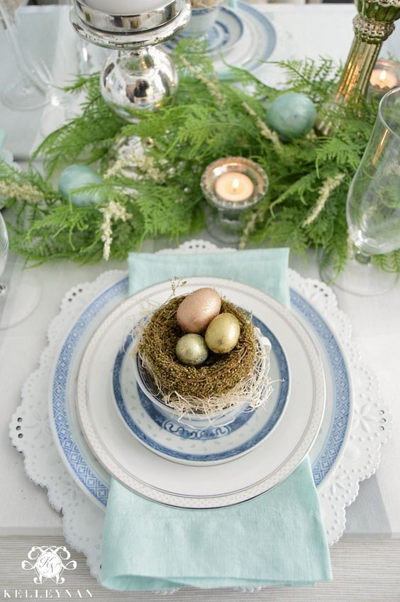 a lace trim platter, blue plates and a nest with shiny eggs