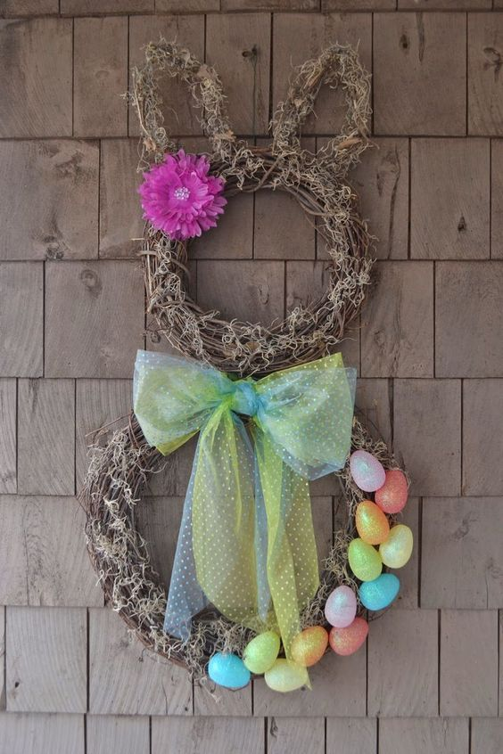 a spring Easter wreath with faux eggs and a bow