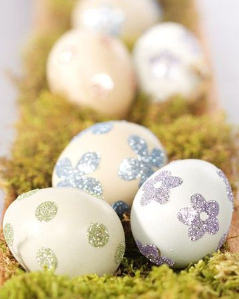 eggs decorated with glitter patterns