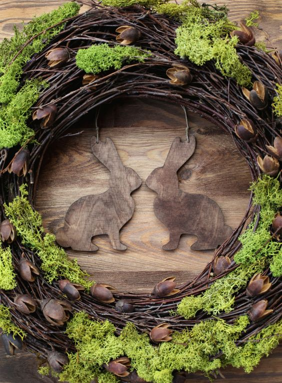 rustic grapevine wreath with wooden bunnies and moss