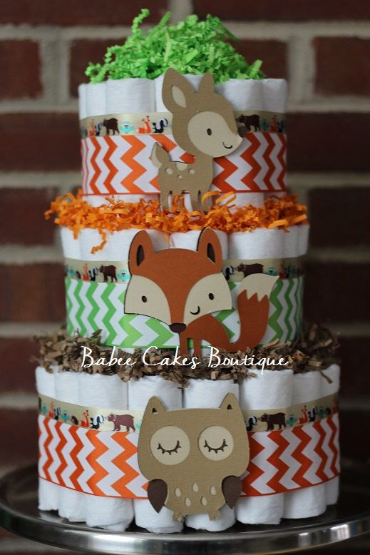 three-tiered woodland nappies cake with animal props