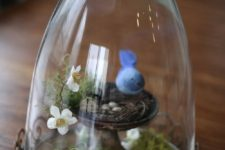 05 a cloche with moss and a tiny bird nest, a felt birdie and flowers