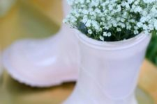 05 blush rubber boots with baby's breath are adorable for a girl's shower