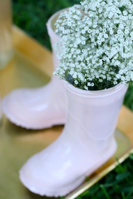 blush rubber boots with baby's breath are adorable for a girl's shower