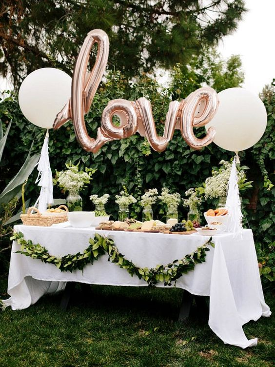 rose gold letter balloons for decorating a dessert table