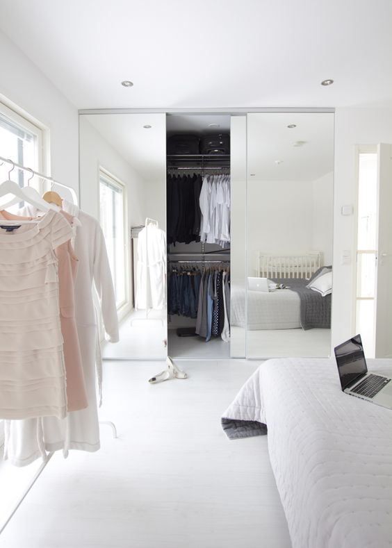 sliding mirror closet doors with no handles for a minimalist look if you have a well organized closet