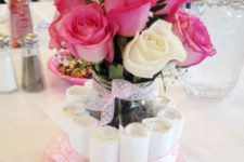 06 a diaper centerpiece with a vase and fresh pink roses