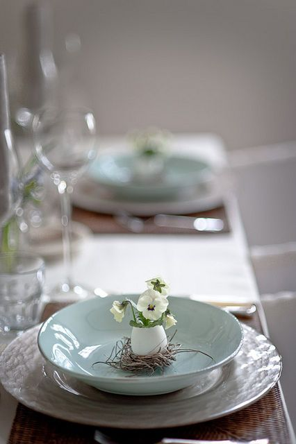 a textured platter, a mint plate and an egg with spring blooms