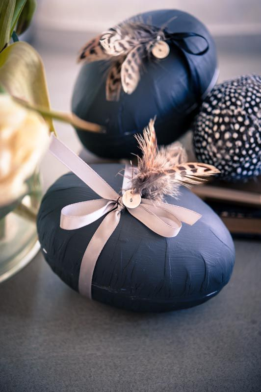 fabric covered Easter eggs with ribbon and feathers