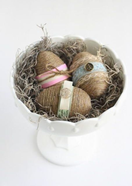 twine covered Easter eggs with buttons and lace