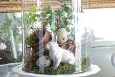 07 a cloche with speckled eggs, greenery, moss and a bunny
