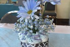 07 a diaper centerpiece with blue flowers and a paper elephant