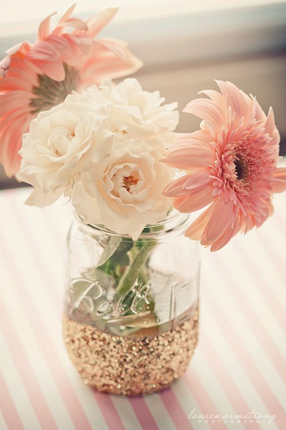 a glitter mason jar with blush and pink blooms is great for any girlish event