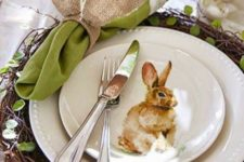 07 a woven platter with leaves, a bunny plate, a green napkin with an ear napkin ring
