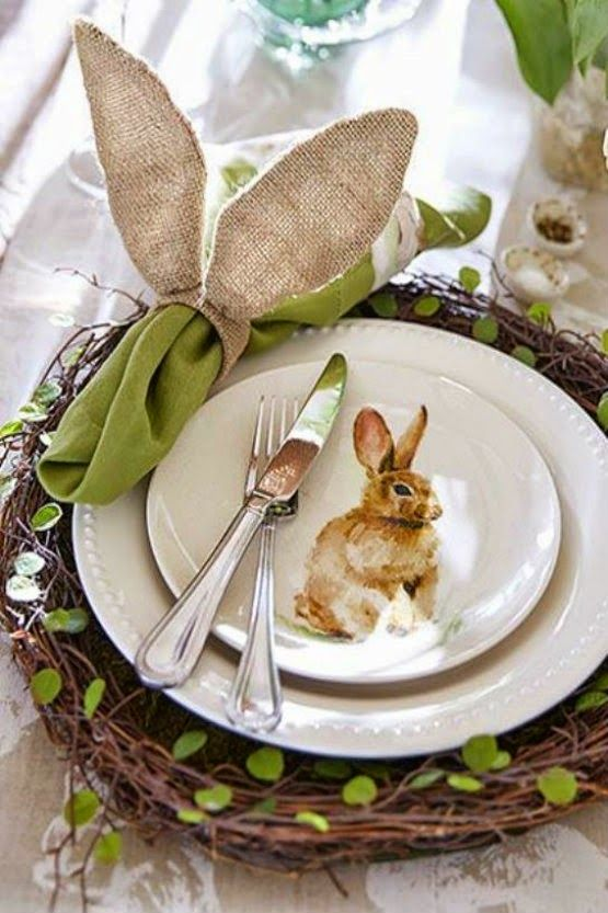 a woven platter with leaves, a bunny plate, a green napkin with an ear napkin ring