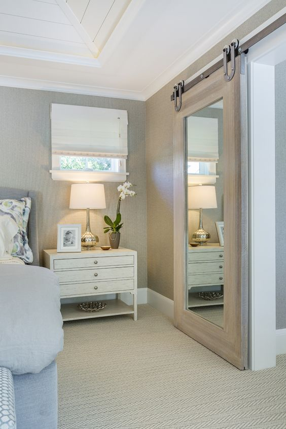 light wood framed barn mirror door will add a cool rustic touch and save the space