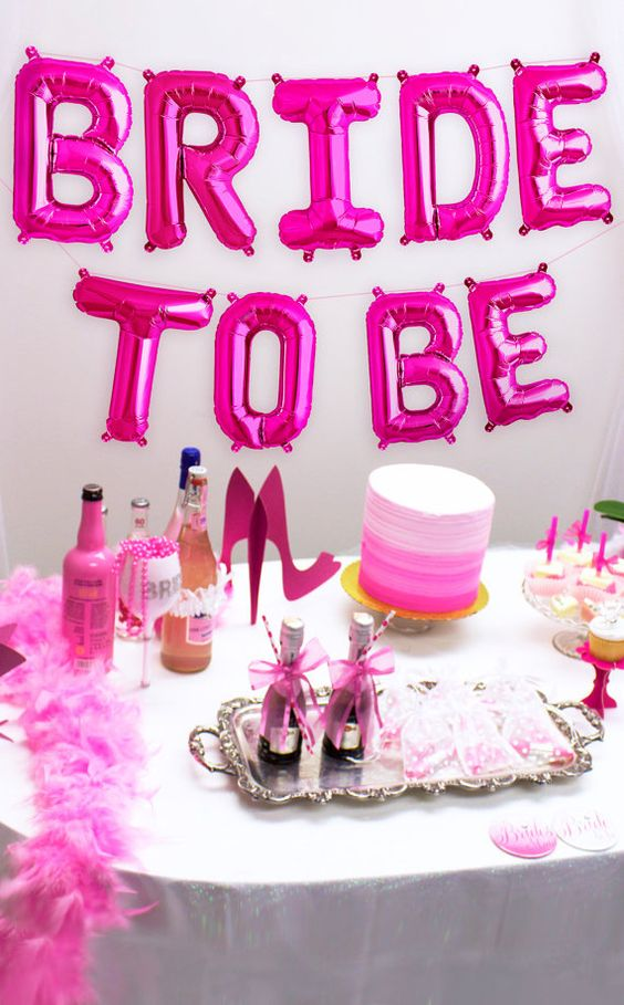 neon pink BRIDE TO BE letter balloons for a dessert table