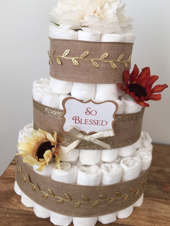 rustic-inspired diaper cake with burlap and gold leaf ribbon