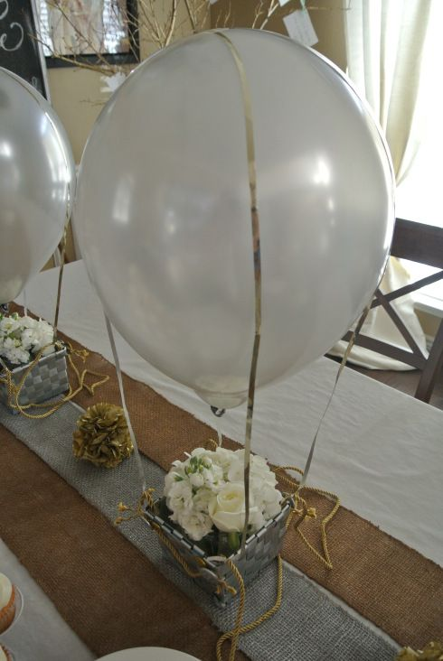 silver baskets with white flowers and balloons