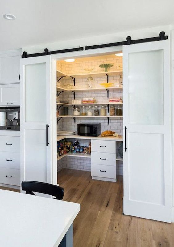 sliding barn doors for your pantry and to save kitchen space