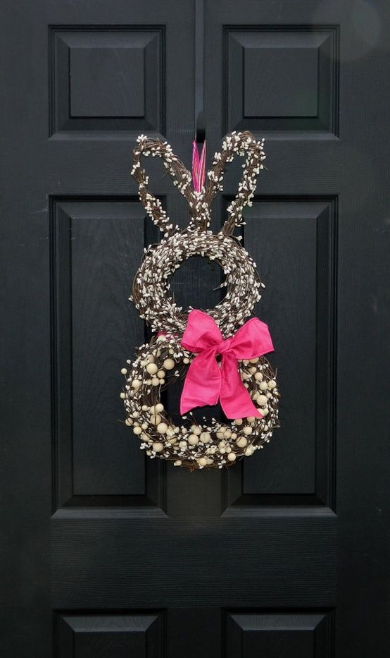 willow bunny wreath with a pink bow is a cool idea for outdoors