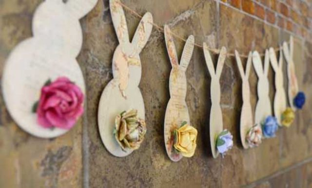 a bunny garland of vintage paper and with rose tails