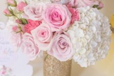 08 a glitter vase with pink and white florals and a tiara