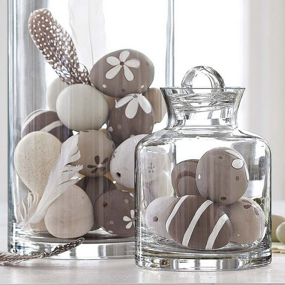 faux eggs in jars decorated in greys and pastels