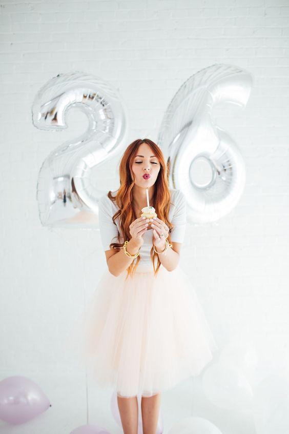 silver 26 balloons as a backdrop for a party