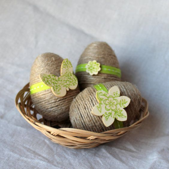 twine wrapped Easter eggs with wooden decorations