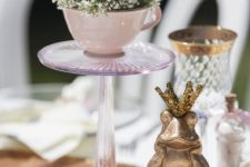 09 a pink cup with baby's breath and a butterfly on a glass stand