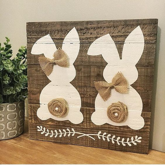 adorable dual bunny hand painted on a reclaimed wood plank sign