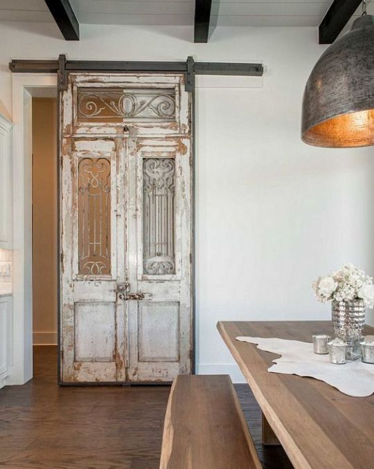 antique door turned a sliding barn one for a refined touch
