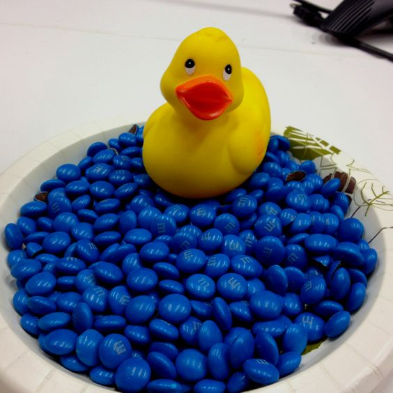 blue M&Ms and a duck for a boy's baby shower