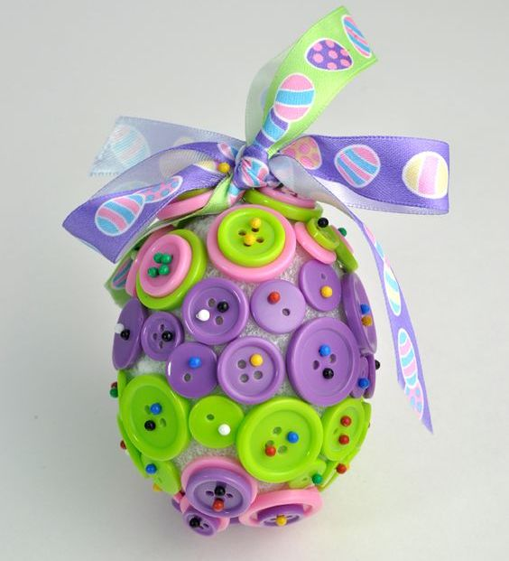 colorful button Easter egg with a ribbon bow for fun