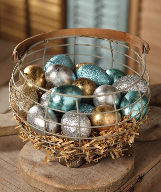 glitter and foil Easter eggs in a wire basket
