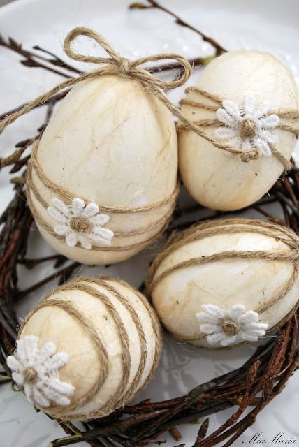 wooden Easter eggs with twine and flowers