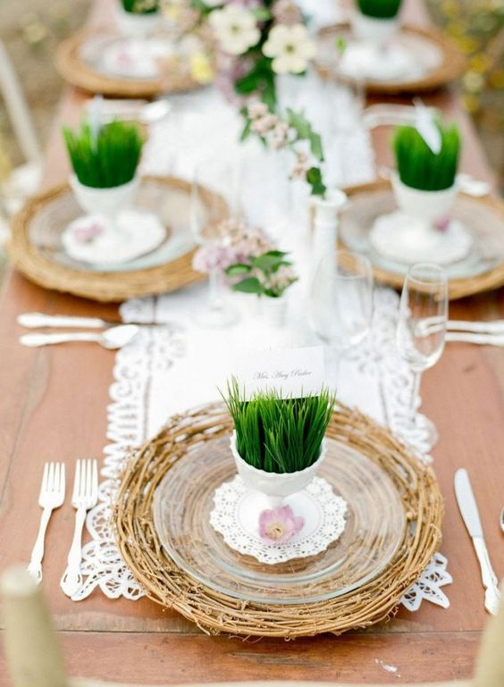 a branch platter, sheer plates and grass in cups to hold the cards