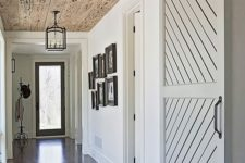 10 a sliding barn door and pecky cypress ceiling turn an ordinary side hallway into a stunning entrance
