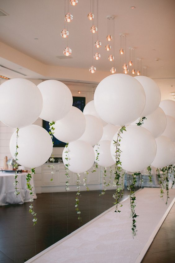 giant white balloon entrance idea for an engagement party