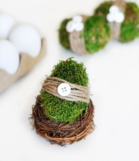 moss covered Easter eggs with twine, buttons and in nests