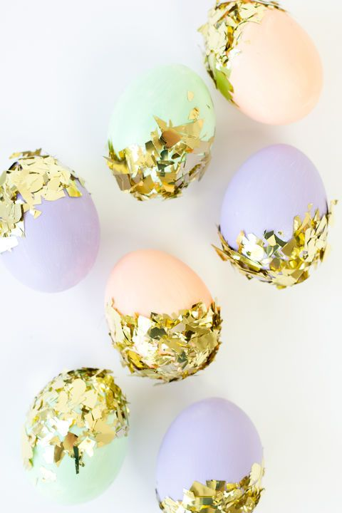 pastel eggs decorated with gold foil in a messy way