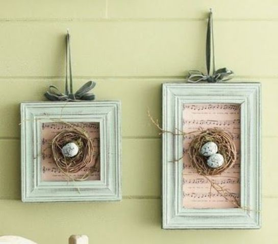 vintage frames with music paper and nests with speckled eggs
