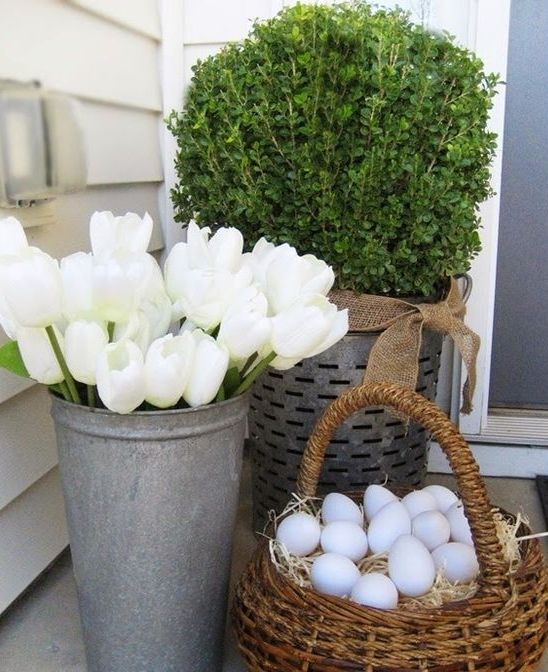 white tulips in a bucket and eggs in a basket for a stylish porch