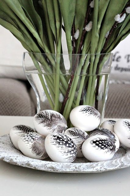 Easter eggs with feathers attached are a creative idea